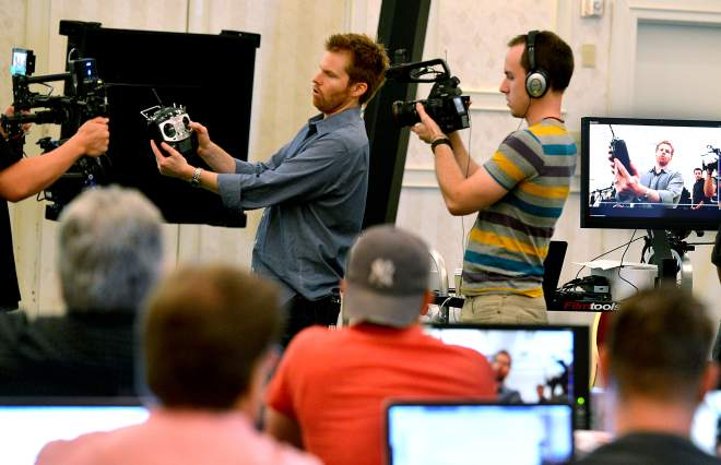 Advocate staff photo by PATRICK DENNIS -- Alex Buono, a longtime 'Saturday Night Live' director, explains how he uses remotes and cameras during his visual storytelling video workshop Sunday at the Baton Rouge Marriott. Assisting, right, is Ben Struble, with Monte Zucker Photographic Education.